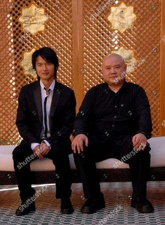 Stock Photo of Chinese Director Shangjun Cai (r) and Actor Lu Yulai Pose For a Photo During the Seventh Marrakesh Film Festival in Morocco 08 December 2007 Shangjun's Film 'The Red Awn' is Presented to Compete at the Festival Which Runs Until December 15 and Will Feature 110 Films in All