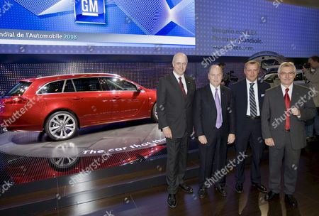 President of General Motors Europe Carl Peter Forster (l) Marketing Chief Alain Visser (2-r) and Chariman of the the Board and Engineering Hans Demant (r) Pose Near Opel's New Insignia Model During the Opel Press Conference On the First Press Day of the 'Mondial De L'automobile 2008' Motor Show in the Portes De Versailles Paris France 02 October 2008