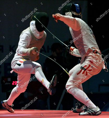 Germany's Peter Joppich (l) and Kwok Kin Lau of Hong Kong in Action During Their Match at the Fencing World Championships in St Petersburg Russia 30 September 2007