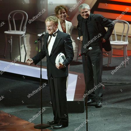 Polish Actor Daniel Olbrychski (l) Smiles Receiving the Stanislavsky 'I Believe' Prize From French Film Director Writer Cinematographer Actor and Producer Claude Lelouch (r) During the Closing Ceremony of the 29th Moscow Film Festival Russia 30 June 2007