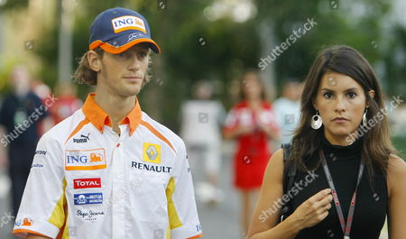 French Formula One Driver Romain Grosjean of Renault F1 Team and His Girlfriend Marion Jolles Walk Through the Paddock of Marina Bay Street Circuit in Singapore 24 September 2009 the Formula One Grand Prix of Singapore Will Take Place On 27 September 2009