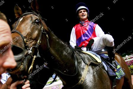 A Jubilant Australian Jockey Danny Nikolic Posing For Pictures with His Horse Mummify After Wining the Singapore Airlines International Cup Mummify From Australia Came in First During the Race Followed by Phonenix Reach From Great Britain and Epaolo From Germany the Winning Team Wins a Total of S$1 59million (760 711 Euros) in Prize Money