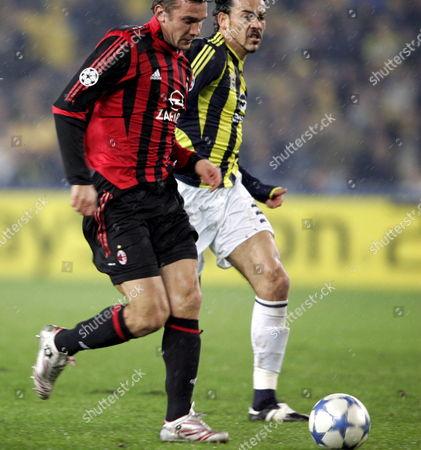 Ac Milan's Ukrainian Player Andriy Schevchenko Vies with Fenerbahce's Servet Cetin (r) During Their Champions League Group E Match at Sukru Saracoglu Stadium in Istanbul Turkey On Wednesday; 23 November 2005