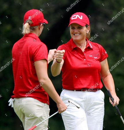 Lorie Kane (r) and Alena Sharp (l) of Canada Celebrate a Birdie at the 15th Green On the First Day of the Women's World Cup of Golf Played at the Gary Player Country Club at Sun City South Africa 18 January 2008