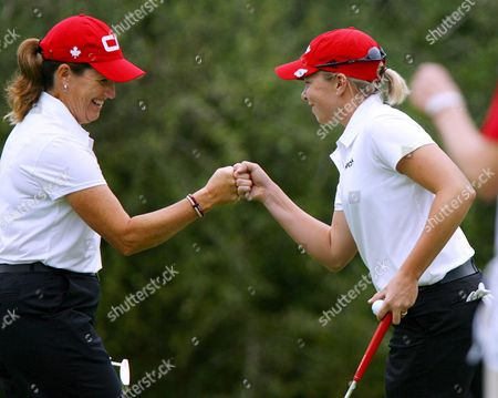 Lorie Kane (l) and Alena Sharp (r) of Canada Celebrate a Birdie Putt On the 5th Green On the Second Day of the Women's World Cup of Golf Played at the Gary Player Country Club at Sun City South Africa 19 January 2008