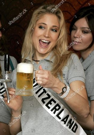 Fiona Hefti Miss Switzerland 2005 Shows with Pride the Beer She Pulled During a Visit by the 81 Miss Universe 2005 Contestants with the Reigning Titleholder to the Pathum Thani Brewery Which Makes Singha Beer On the Outskirts of Bangkok Thailand Wednesday 18 May 2005 the Beauty Contestants Were Allowed to Pull Beers On Tap Toast For Pictures But not Drink As Strict Rules Dictate the Girls Public Behaviour a Row Wednesday Over Contestants Wearing Bikinis in Front of Buddhist Sites Broke out Forcing Organisers to Say the Scenes Would Be Edited out of Official Tv Footage the Finals of the 54th Annual Miss Universe Competition Will Take Place in Bangkok Thailand On 31 May 2005