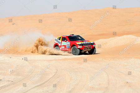 France's Luc Alphand and Giles Picard Drive Their Mitsubishi During the Final Round of the Uae Desert Challenge Rally at the Desert of Hameem Some of 400km South-east of Dubai United Arab Emirates 01 November 2007