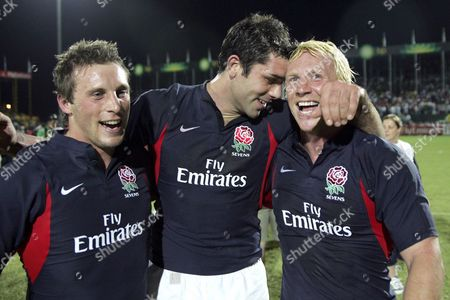 England Rugby Players Paul Sampson (l) Pat Sanderson (c) and Peter Richards (r) Celebrate After Defeating Fiji in the Final of the Dubai Rugby Sevens in Dubai United Arab Emirates Friday 03 December 2004 England Defeated Fiji 26-21