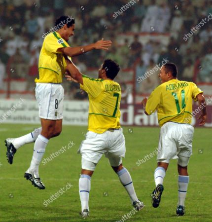 Stock Picture of Brazilian Players Dudu (l) Daniel Carvalho (c) and Adriano (r) Celebrate Their Win After the Fifa Youth Quarter-final Match in Dubai On Friday 12 December 2003 Brazil Won 5-1