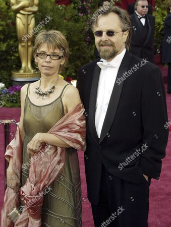 Polish Composer Jan a P Kaczmarek (r) and His Wife Elzbieta Arrive On the Red Carpet For the 77th Academy Awards at the Kodak Theatre in Hollywood Sunday 27 Febuary 2005