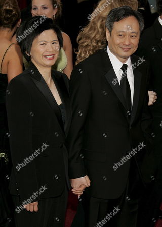 Director Ang Lee and His Wife Jane Lin (l) Pose On the Red Carpet As They Arrive For the 78th Annual Academy Awards in Hollywood California Sunday 05 March 2006