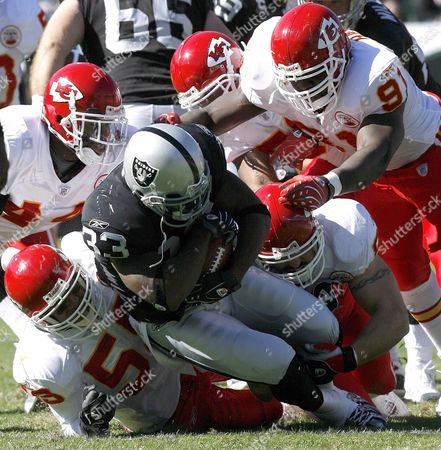 Oakland Raiders Runningback Dominic Rhodes (c) Gets Stuffed by Kansas City Chiefs Defensive Donnie Edwards (l) Jared Allen (2-r) and Tamba Hali (r) During the Second Quarter of Their Nfl Game in Oakland California Usa 21 October 2007
