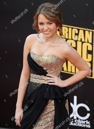 Stock Picture of Us Actress and Singer-songwriter Mylie Cyrus Arrives For the American Music Awards in Los Angeles California in Los Angeles California Usa 23 November 2008