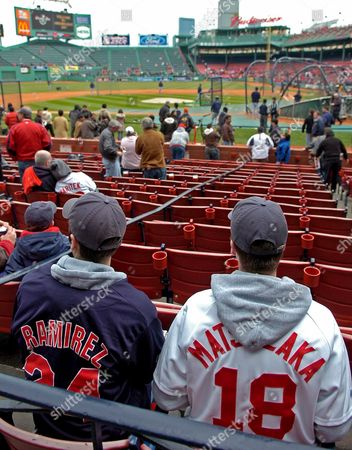 Mark Bruno (l) and Sean Mahoney of Peabody Massachusetts Wait For the Start of the Red Sox Home Opener Against the Seattle Mariners at Fenway Park in Boston Massachusetts Tuesday 10 April 2007