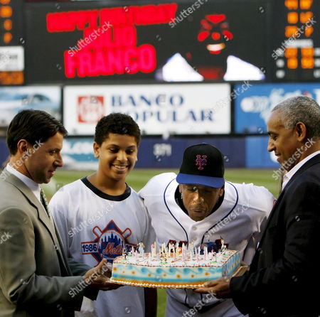 New York Mets Owner Steve Wilpon (l) and Mets General Manager Omar Minaya (r) Hold a Birthday Cake For the Mets' Julio Franco (c) While He Blows out the Candles On His 48th Birthday Before the Game Between the St Louis Cardinals' Game Against the New York Mets at Shea Stadium in Queens New York On Wednesday 01 August 2006 Second From Left is Franco's Son Joshua