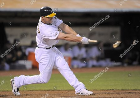 Oakland Athletics Matt Holliday Shatters His Bat While Grounding-out Off a Pitch by Toronto Blue Jays Pitcher Scott Richmond During the Eighth Inning at the Oakland-alameda County Coliseum in Oakland California Usa 08 May 2009 the Athletics Defeated the Blue Jays 5-3