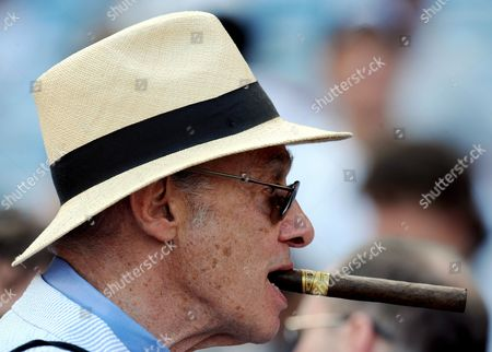 Legendary Boxing Writer Bert Sugar Chews On a Cigar During Batting Practice Prior to the Start of the 79th Annual Baseball All-star Game at Yankee Stadium in New York City New York Usa 15 July 2008