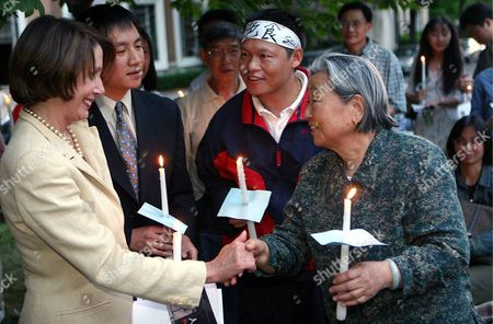 House Minority Leader Nancy Pellosi (l) Greets Li Jing Xiu (r) Arthur Liu (c) and Dan Wang (l) As Members of the Public Gathered in Front of the Chinese Embassy in Washington Thursday 03 June 2004 For a Candle Light Vigil to Mark the 15th Anniversary of the Tiananmen Square Protests Which Claimed the Lives of Hundreds of Chinese Pro-democracy Protestors Liu and Wang Are Both Former Student Leaders While Xiu's Son Yang Jian Li Was Imprisoned For 5 Years by the Chinese Government For His Role in the Protests