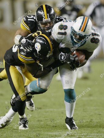 Pittsburgh Steelers' Tyrone Carter (l) and James Farrior (c) Tackle Miami Dolphins' Randy Mcmichael During the Fourth Quarter at Heinz Field in Pittsburgh Pennsylvania Thursday 07 September 2006 Porter Also Had an Interception Return For a Touchdown During Their 28-17 Win