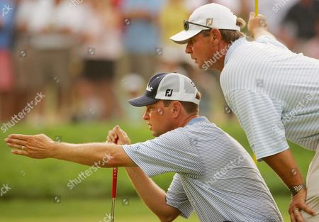 Davis Love Iii (l) of the Us and His Caddie John Burke (r) Line Up a Putt On The18th Green at the End of the Third Round of the 2005 Pga Championship in Which Love Shot Two Strokes Under Par at Baltusrol Golf Club in Springfield New Jersey Saturday 13 August 2005 Love and Compatriot Phil Mickelson Are Now Tied For the Lead in the Competition Each Shooting Six Strokes Under Par