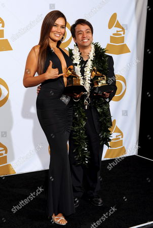 Us Actress and Recording Artist Tia Carrere (l) and Daniel Ho Hold Their Grammy Award For Best Hawaiian Music Album For 'Ikena' at the 51th Annual Grammy Awards at the Staples Center in Los Angeles California Usa 08 February 2009