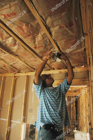 Stock Picture of Louis Hunter Hangs Insulation at His Parent's House in the Lower Ninth Ward of New Orleans Louisiana Wednesday 31 May 2006 the Atlantic Hurricane Season Begins 1 June and Many New Orleanians Will Be Nervously Watching the Tropics After Hurricane Katrina Devastated New Orleans and the Mississippi Gulf Coast 29 August 2005 Hurricane Season Runs Through 30 November
