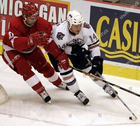 Edmonton Oilers' Raffi Torres (r) Tries to Score As Detroit Red Wings' Robert Lang Defends in Game Two of Their First Round Playoff Match at Joe Louis Arena in Detroit On Sunday 23 April 2006