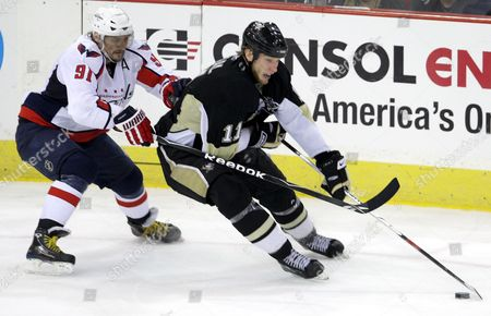 Pittsburgh Penguins' Jordan Staal (r) Carries the Puck Up Ice As Washington Capitals' Sergei Fedorov (l) of Russia Defends During the Third Period of an Nhl Eastern Conference Playoff Hockey Game in Pittsburgh Pennsylvania Usa 11 May 2009