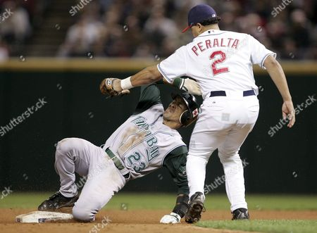 Julio Lugo (l) of the Tampa Bay Devil Rays is Tagged out by Jhonny Peralta (r) of the Cleveland Indians While Trying to Steal Second Base During the Ninth Inning at Jacobs Field in Cleveland Ohio Tuesday 27 September 2005 the Devil Rays Defeated the Indians 5-4