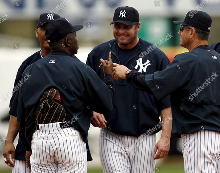 New York Yankees First Basemen Jason Giambi Shares a Laugh with Coaches Mickey Rivers and Larry Bowa at Major League Baseball Spring Training at Legends Field in Tampa Florida Friday 24 February 2006