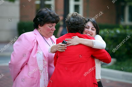 Family Members of Victims of the September 11 Attacks Carie Lemack (r) and Rosemary Dillard (c) Embrace Watched by Lisa Dolan (l) Following the Jury's Verdict in the Trial of Al-qaeda Plotter Zacarias Moussaoui Outside the United States District Court For the Eastern District of Virginia Wednesday 3 May 2006 Zacarias Moussaoui Was Sentenced to Life in Prison