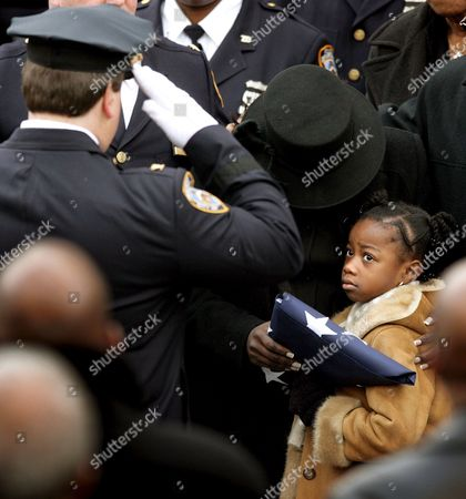 Alexis Stewart (r) the Six Year Old Daughter of Slain New York City Police Department Detective Dillon Stewart and Her Mother Leslyn (c) Clutch an American Flag From Stewart's Coffin While Being Saluted Outside of the New Life Tabernacle Church After the Funeral Tuesday 06 December 2005 in Brooklyn New York Stewart a Married Father of Two Was Gunned Down Last Monday While He and His Partner Were Chasing a Driver Who Had Allegedly Run a Red Light