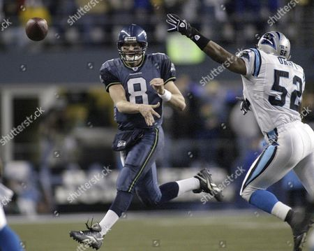 Seattle Seahawks' Quarterback Matt Hasselbeck (l) Makes a Running Pass As Carolina Panthers' Linebacker Chris Draft (r) Defends During the Third Quarter of the Nfc Championship Playoffs at Qwest Field in Seattle Washington Sunday 22 January 2006