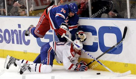 The Rangers' Aaron Voros (l) Fights For the Puck with the Canadiens' Maxim Lapierre (r) During the Second Period of the Game Between the Montreal Canadiens and New York Rangers at Madison Square Garden in New York New York Usa On 07 January 2009