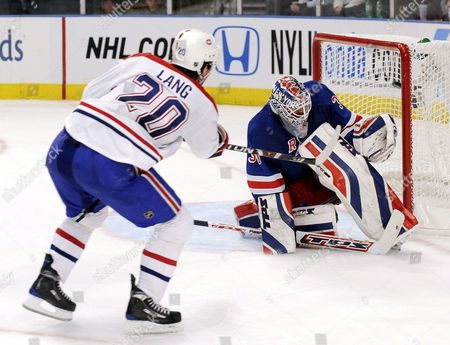 The Canadiens' Robert Lang (l) Scores a Goal Past the Rangers' Henrik Lundqvist (r) During the Third Period of the Game Between the Montreal Canadiens and New York Rangers at Madison Square Garden in New York New York Usa On 07 January 2009