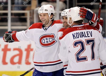 The Canadiens' Robert Lang (l)celebrates with Teammates Tomas Plekanec (c) and Alexei Kovalev (r)after Scoring One His Three Goals During the Third Period of the Game Between the Montreal Canadiens and New York Rangers at Madison Square Garden in New York New York Usa On 07 January 2009