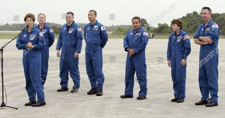 Stock Photo of The Sts-114 Nasa Flight Crew Arrives at Kennedy Space Center (ksc) Florida Saturday 9 July 2005 in Preparation For the Launch of Nasa Shuttle Discovery On 13 July 2005 Crew Members Are Commander Elleen M Collins (front) (l-r) Andrew S W Thomas James M Kelly (pilot) Soichi Noguchi Charles J Camarda Wendy B Lawrence and Stephen K Robinson After Arriving at Ksc the Crew Arrived One Day Early Due to Hurricane Dennis Traveling Up the Gulf Coast