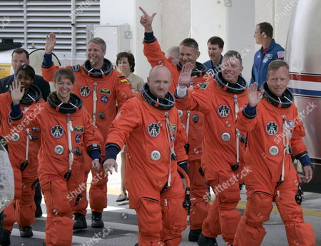 The Sts-121 Nasa Flight Crew Leaving the Operations and Checkout Building (onc) Under Tight Security at Kennedy Space Center (ksc) Cape Canaveral Florida Saturday 01 July 2006 For Launch Pad 39b Astronauts (l-r)pilot Mark E Kelly Commander Steven W Lindsey Mission Specialist Lisa M Nowak Michael E Fossum Piers J Sellers Stephanie D Wilson and European Space Agency (esa) Astronaut Thomas Reiter of Germany Wave Before Entering the Van That Will Transport the Crew to the Launch Pad