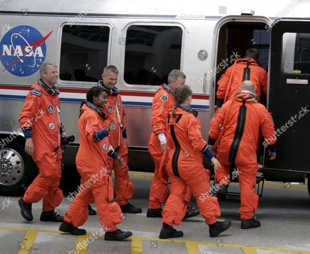 The Sts-121 Nasa Flight Crew Leaving the Operations and Checkout Building (onc) Under Tight Security and Boarding an Airstream Van at Kennedy Space Center (ksc) Cape Canaveral Florida Sunday 02 July 2006 For Launch Pad 39b Astronauts (l-r) Pilot Mark E Kelly Commander Steven W Lindsey Mission Specialist Lisa M Nowak Michael E Fossum Piers J Sellers Stephanie D Wilson and European Space Agency (esa) Astronaut Thomas Reiter of Germany Wave Before Entering the Van That Will Transport the Crew to the Launch Pad