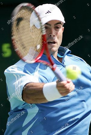 Daniele Bracciali of Italy Returns the Ball to George Basil of Switzerland During Their First Round Match at the the Nasdaq-100 Open On Key Biscayne Florida Friday 24 March 2006