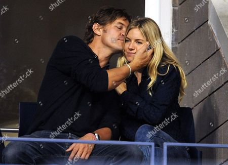 Actress Sienna Miller Sits with George Barker Also Known As Dj Slinky Wizard During the Fifth Day of the 2009 Us Open Tennis Championship at the Usta National Tennis Center in Flushing Meadows New York Usa 04 September 2009 the Open Runs Through Sunday 13 September 2009 United States Flushing Meadows
