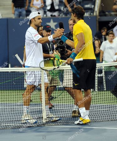 Rafael Nadal of Spain Shakes Hands with Nicolas Kiefer of Germany After Defeating Him During the Fifth Day of the 2009 Us Open Tennis Championship at the Usta National Tennis Center in Flushing Meadows New York Usa 04 September 2009 the Open Runs Through 13 September 2009