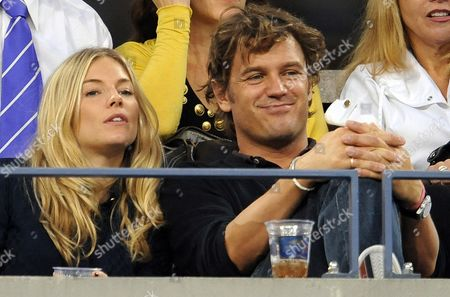 Actress Sienna Miller Sits with George Barker Also Known As Dj Slinky Wizard During the Fifth Day of the 2009 Us Open Tennis Championship at the Usta National Tennis Center in Flushing Meadows New York Usa 04 September 2009 the Open Runs Through Sunday 13 September 2009