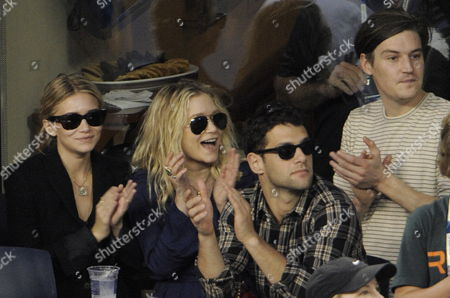 Stock Picture of Us Actress Ashley Olsen (l) Her Boyfriend Us Actor Justin Bartha (2nd R) Us Actress Mary Kate Olsen (2nd L) and Her Boyfriend Us Artist Nate Lowman (r) Watch Novak Djokovic of Serbia Play Roger Federer of Switzerland During Their Semifinal Match at the 2009 Us Open Tennis Championship at the Usta National Tennis Center in Flushing Meadows New York Usa 13 September 2009 the Winner of the Match Will Play Juan Martin Del Potro of Argentina in the Men's Final