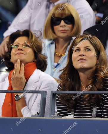 Mirka Federer (r) Wife of Roger Federer of Switzerland Sits with His Mother Lynette Federer (l) During Federer's Match with Simon Greul of Germany On the Third Day of the 2009 Us Open Tennis Championship at the Usta National Tennis Center in Flushing Meadows New York Usa 02 September 2009 the Open Runs Through Sunday 13 September 2009 Vogue Editor in Chief Anna Wintour is in Background