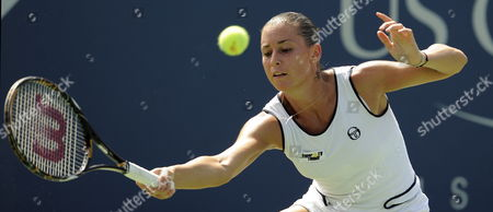 Flavia Pannetta of Italy Hits a Return Against Aleksandra Wozniak of Canda During the Fifth Day of the 2009 Us Open Tennis Championship at the Usta National Tennis Center in Flushing Meadows New York Usa 04 September 2009 the Open Runs Through Sunday 13 September 2009