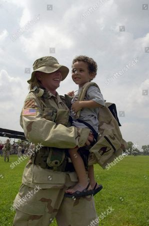 Spc Erin Gibson Holds Her Elated Son Elijah 2 As Elements of the U S Army's 3rd Infantry Division Returned From Duty in Iraq On Saturday 09 August 2003 at Fort Stewart in Hinesville Ga the Unit Which Had Been Deployed in Kuwait and Iraq For More Than Seven Months Has Lost 38 Soldiers in the Conflict Gibson Said It Was Horrible Being Separated by Her Son For So Long Epa Photo/epa/erik S Leser United States Hinesville