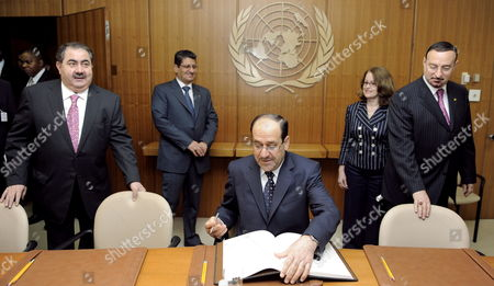 Nouri Kamil Al-maliki (c) Prime Minister of Iraq Signs a Guest Book at the Start of a Meeting with United Nations Secretary General Ban Ki-moon at the Start of a Meeting at United Nations Headquarters in New York New York Usa On 22 July 2009 at Left is Iraqi Foreign Minister Hoshyar Zebar