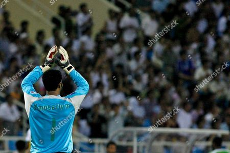 Stock Image of Saudi Arabia's Keeper Yasser Al Mosailem Applaudes After His Team Scored Against Japan During Their Asian Football Cup Semifinal Match in Hanoi Vietnam 25 July 2007
