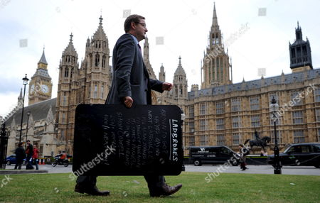 Ladbrooks' Robin Huchision Carries a Ladbrooks Betting Board Giving the Odds On Who Will Be the Next British Prime Minister Outside the Houses of Parliament in London Britain 05 June 2009 Transport Secretary Geoff Hoon Has Become the Third Cabinet Minister to Walk out of Government in the Past Day His Departure Follows John Hutton Who Quit As Defence Secretary and James Purnell Who Resigned As Work and Pensions Secretary On Thursday